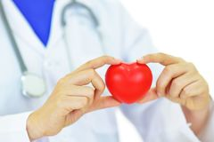 Heart care. Doctor holding heart in hands, heart care concept Stock Images