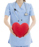 Doctor holding heart in her hands Royalty Free Stock Image