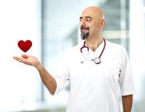 Doctor holding heart shape Stock Photos