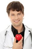 Doctor holding heart shape toy Royalty Free Stock Photo