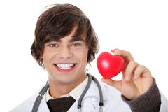 Doctor holding heart shape toy Royalty Free Stock Photos