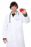 Doctor holding heart shape toy Stock Photo