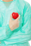 Doctor holding heart shape toy Stock Photos