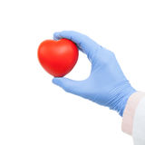 Doctor holding heart shaped toy in hand - close up stock images