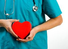 Doctor holding a heart symbol Stock Image