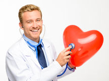 Doctor holding heart on white background Stock Images