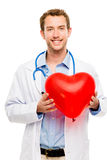 Doctor holding heart white background Royalty Free Stock Photography