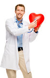 Doctor holding heart white background Stock Images