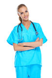 Doctor holding her stethoscope around her neck Royalty Free Stock Images