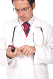 Doctor holding his cellphone Royalty Free Stock Image
