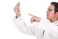 Doctor holding his cellphone Stock Image
