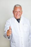 Doctor holding his thumb up Royalty Free Stock Images