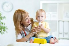 Doctor holding inhaler mask for child breathing Stock Image