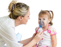 Doctor holding inhaler mask for kid breathing. Hospital Royalty Free Stock Photography