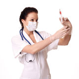 Doctor holding injection Stock Photos