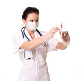 Doctor holding injection Stock Images