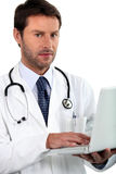 Doctor holding laptop Royalty Free Stock Photo