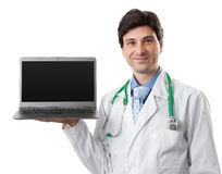 Doctor holding a laptop with blank screen Royalty Free Stock Photography