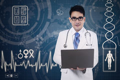 Doctor holding a laptop Stock Images