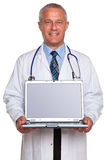 Doctor holding laptop clipping path for screen. Royalty Free Stock Image