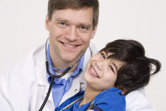 Doctor holding little patient in arms Stock Photography