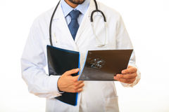 Doctor holding a mammography on white background Stock Image