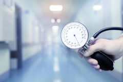 Doctor holding manometer to arterial pressure measurement royalty free stock photography