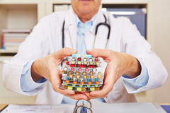 Doctor holding many pills in in hands Royalty Free Stock Images