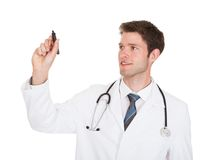 Doctor Holding Marker Royalty Free Stock Photos
