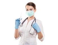 Doctor holding medical injection syringe and stethoscope, isolat Stock Photo