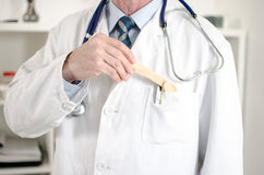 Doctor holding a medical mouth spatula Stock Photo