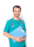 Doctor holding medical records isolated on background Stock Photos