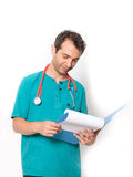 Doctor holding medical records isolated  white background Royalty Free Stock Images