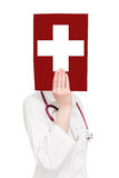 Doctor holding medical symbol Royalty Free Stock Images