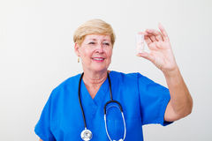 Doctor holding medicine Royalty Free Stock Photography