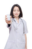Doctor holding medicine bottle over white Stock Images