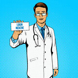Doctor holding medicine box pop art vector Stock Image