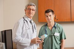 Doctor Holding Medicine Box Stock Photo