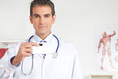 Doctor Holding a Medicine Packet. Portrait of male doctor holding a medicine packet Stock Photo