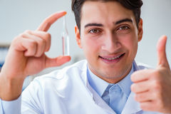 The doctor holding medicines in the lab. Doctor holding medicines in the lab Stock Images