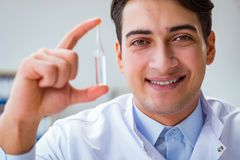 The doctor holding medicines in the lab. Doctor holding medicines in the lab Stock Photography