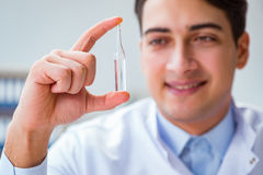 The doctor holding medicines in the lab. Doctor holding medicines in the lab Stock Image