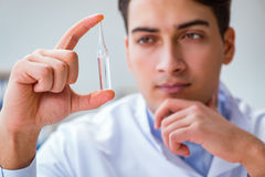 The doctor holding medicines in the lab. Doctor holding medicines in the lab Stock Photo