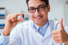 The doctor holding medicines in the lab. Doctor holding medicines in the lab Royalty Free Stock Photos