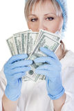 Doctor holding money Stock Photo