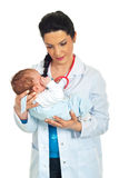Doctor holding newborn baby Royalty Free Stock Images