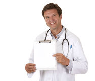 Doctor holding notes. Caucasian doctor is holding notes on white isolated background Royalty Free Stock Image