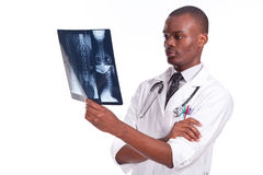 Doctor holding and observing an xray. Young doctor holding and observing an xray stock photo