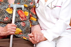 A doctor holding an old woman's hand Stock Photography