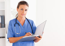 Doctor holding an open folder Stock Photo
